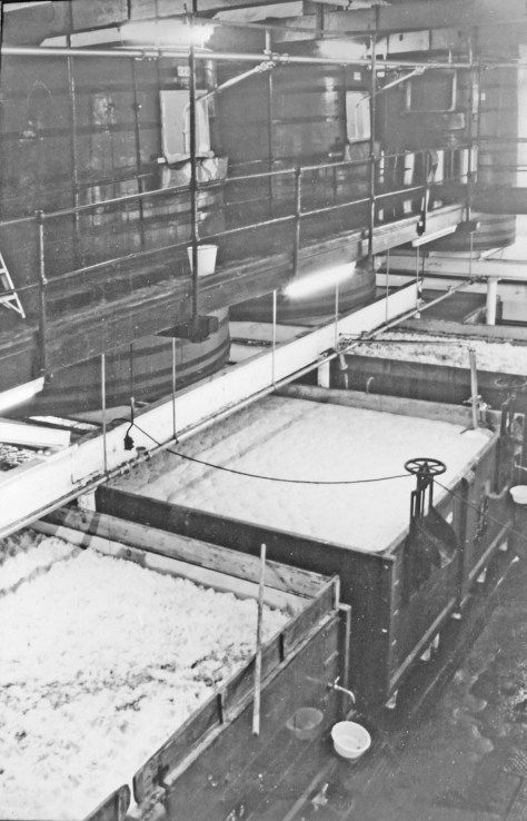"The fermenting room at Fuller's Griffin brewery about 1970, showing the ""dropping"" system in use: fermentation would be started in the upper rounds, and after a day or two the wort would be dropped into the shallower squares below to finish fermentation."