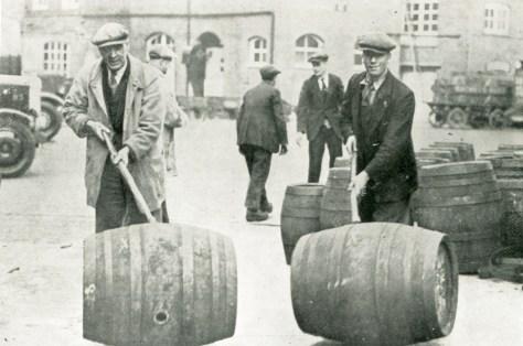 Rolling barrels in the Mortlake brewery yard 1932